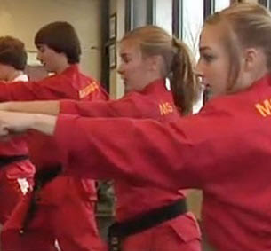 Students gaining flexibility with martial arts