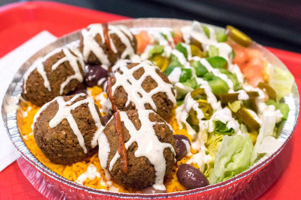 Delicious falafel with yellow rice and salad veggies