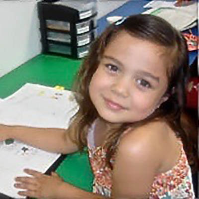 happy child in a tutoring session at The Tutoring Center in Commack, NY
