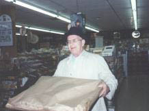 photo of man with large pizza box from Toarmina's Pizza