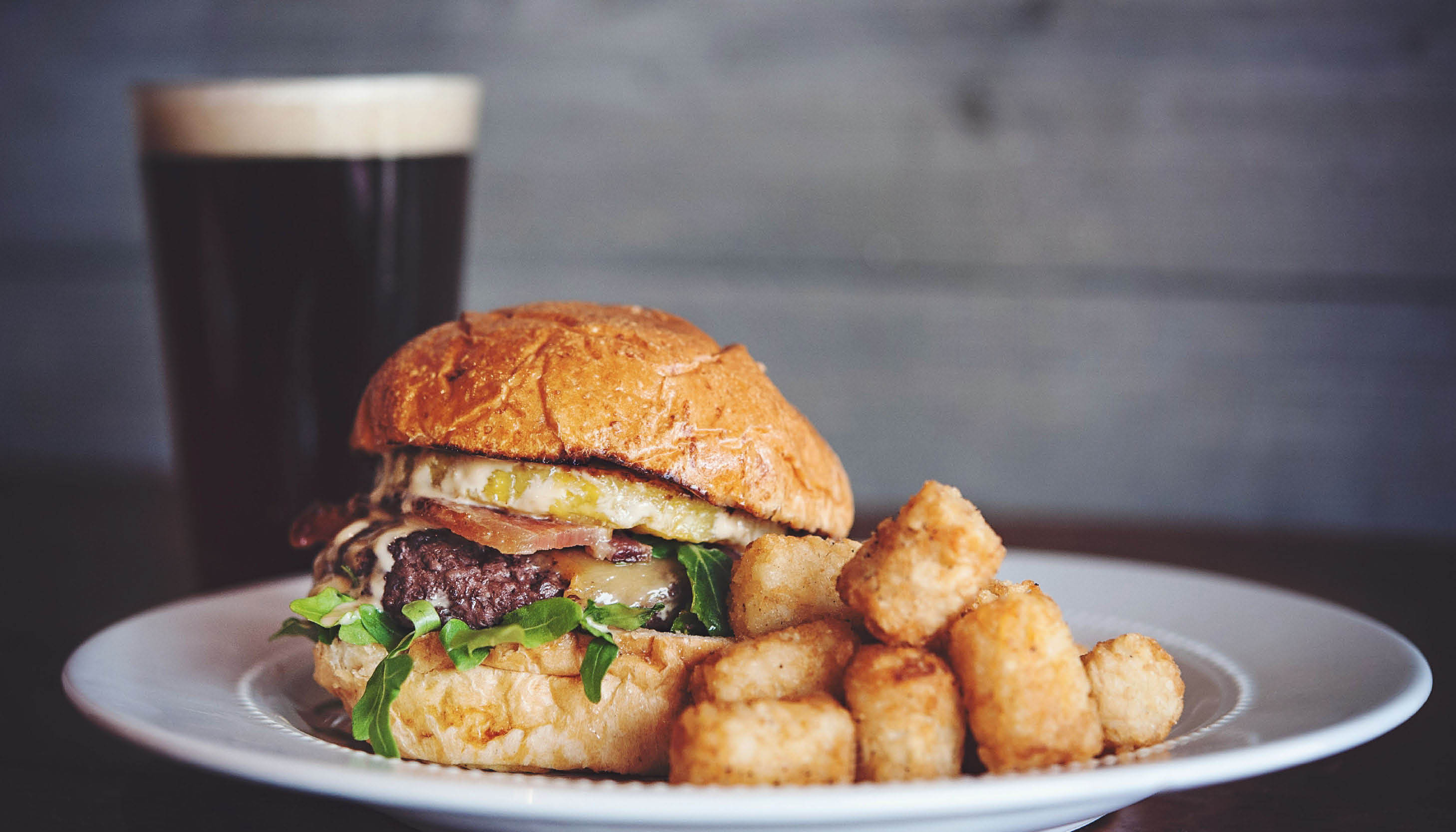 photo of beer and burger from Tony Sacco's in Canton and Hartland, MI