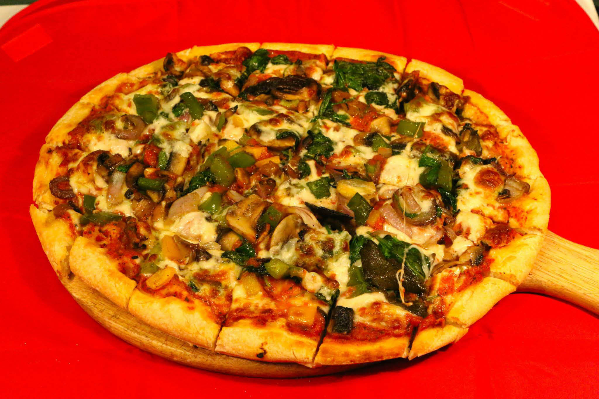 Rustic style vegetable pizza  served up hot at Tuscan Grill