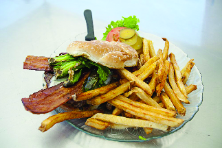 Juicy Jalapeno burger plate with fries