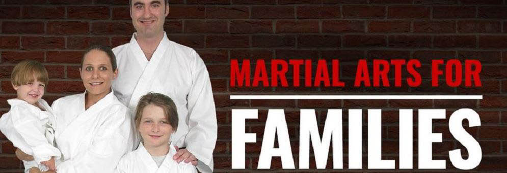 family taking martial arts training at Ultimate Protector Martial Arts Academy in Livonia, MI
