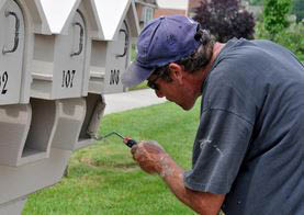 photo of man painting mailboxes from Uncle Squeegee's Window Cleaning in Sterling Heights, MI