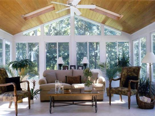 Glassed-in sunroom by Under The Sun Improvements