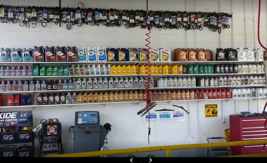 photo of wall of oil at Universal Quick Lube in Warren, MI