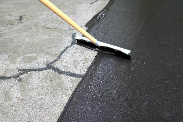 WA Driveway Repair - crack filling - fill the cracks in your driveway with sealcoating from WA Driveway Repair - sealcoat your driveway - pothole repairs