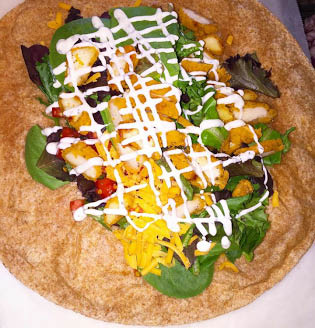 Pita topped with salad at Blend Smoothie and Salad Bar
