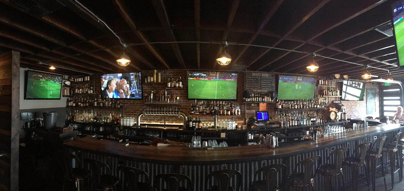 Full bar with 20 TVs to watch your favorite sports on at The Westy Sports & Spirits in Roosevelt and West Seattle, WA