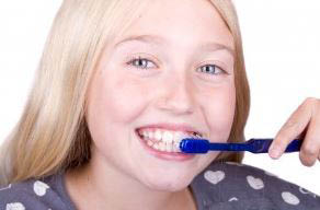 photo of child brushing teeth at Williamson Dental in Huntington Woods, MI