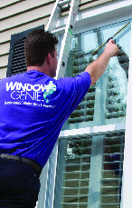 window genie of norman and oklahoma city oklahoma employee cleaning window