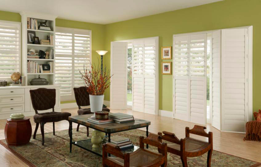 Wooden Shutters and blinds tie a whole room together.