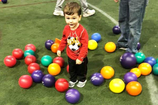 toddler playing at XL Sports World Mt Laurel
