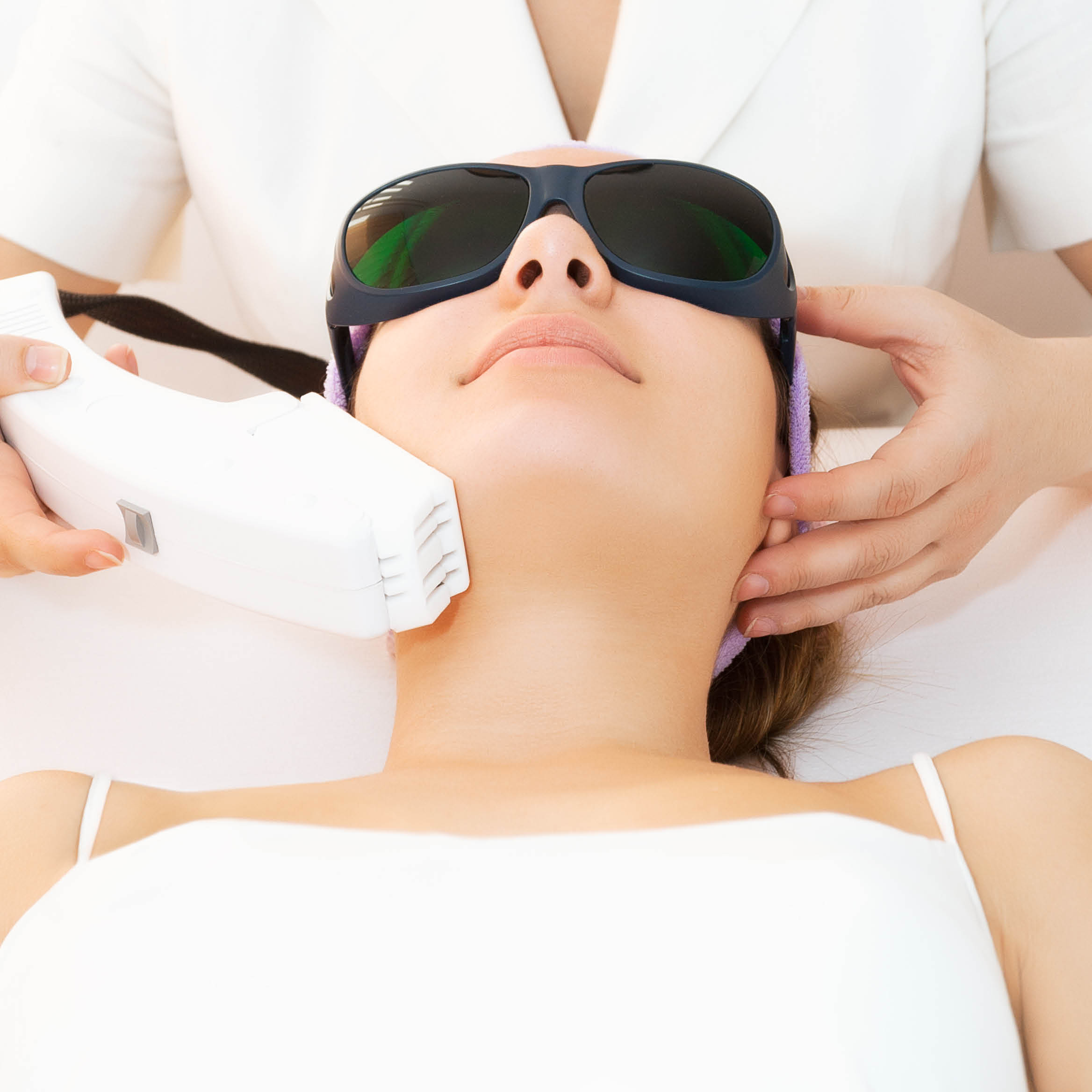 Young woman with laser therapy in progress