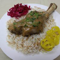 Lamb served over rice