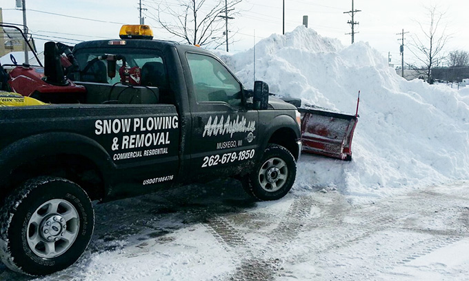 AAA Asphalt Services include Winter Snow Plowing
