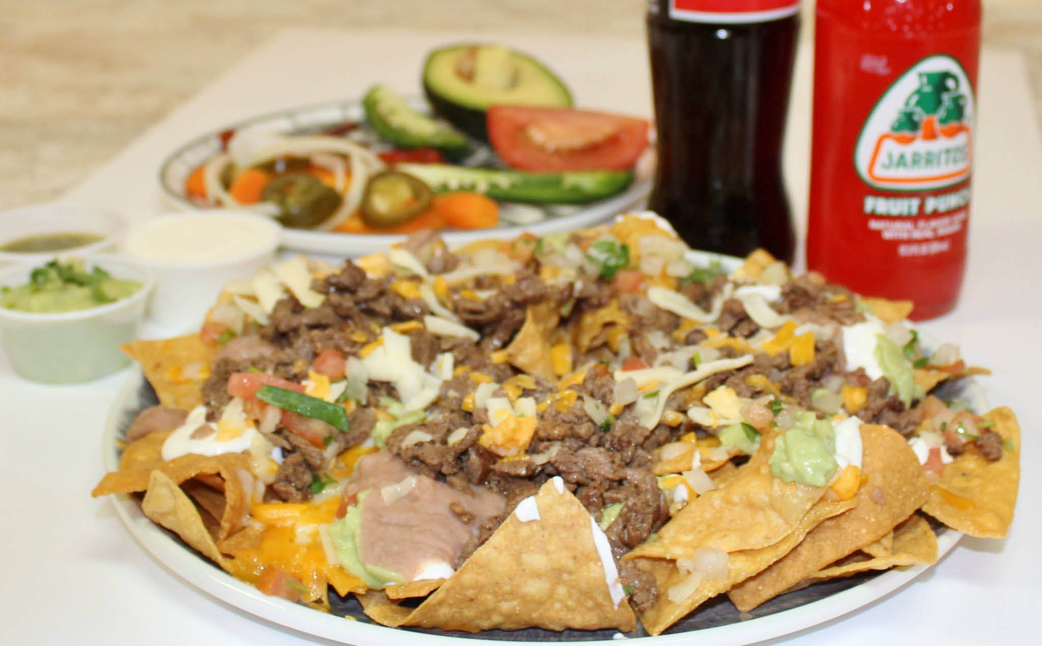 The best Mexican nachos recipe layered with the freshest ingredients