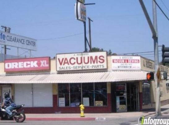 A Rogers Vacuum and Sewing Center storefront; Vacuums, Air Purifiers, Steam Cleaners Sewing Machines and Janitorial Equipment and Supplies