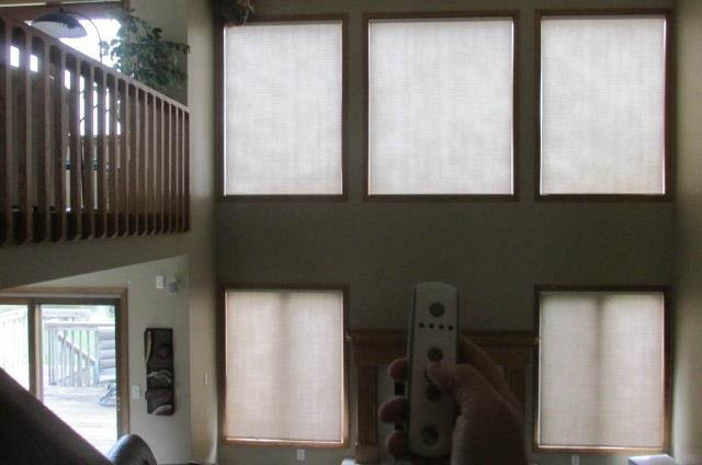 motorized white cellular window shades with remote control; Budget Blinds of Des Moines, IA; Downtown Des Moines