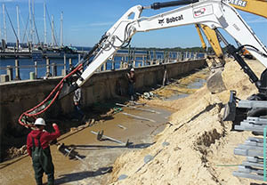 We have the heavy equipment necessary for sea wall repair