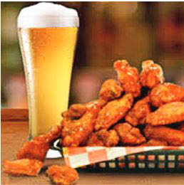 Buffalo wings and draft beer; craft beer
