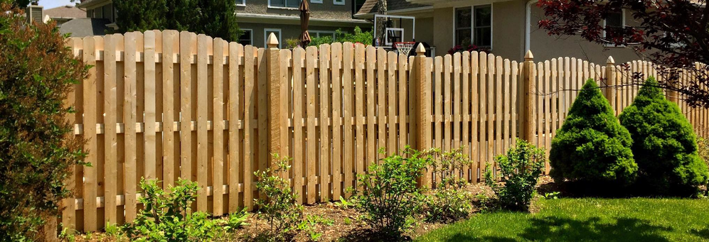 Arched Cedar Shadowbox fence installed by Ameri Dream Fence of Chicagoland.