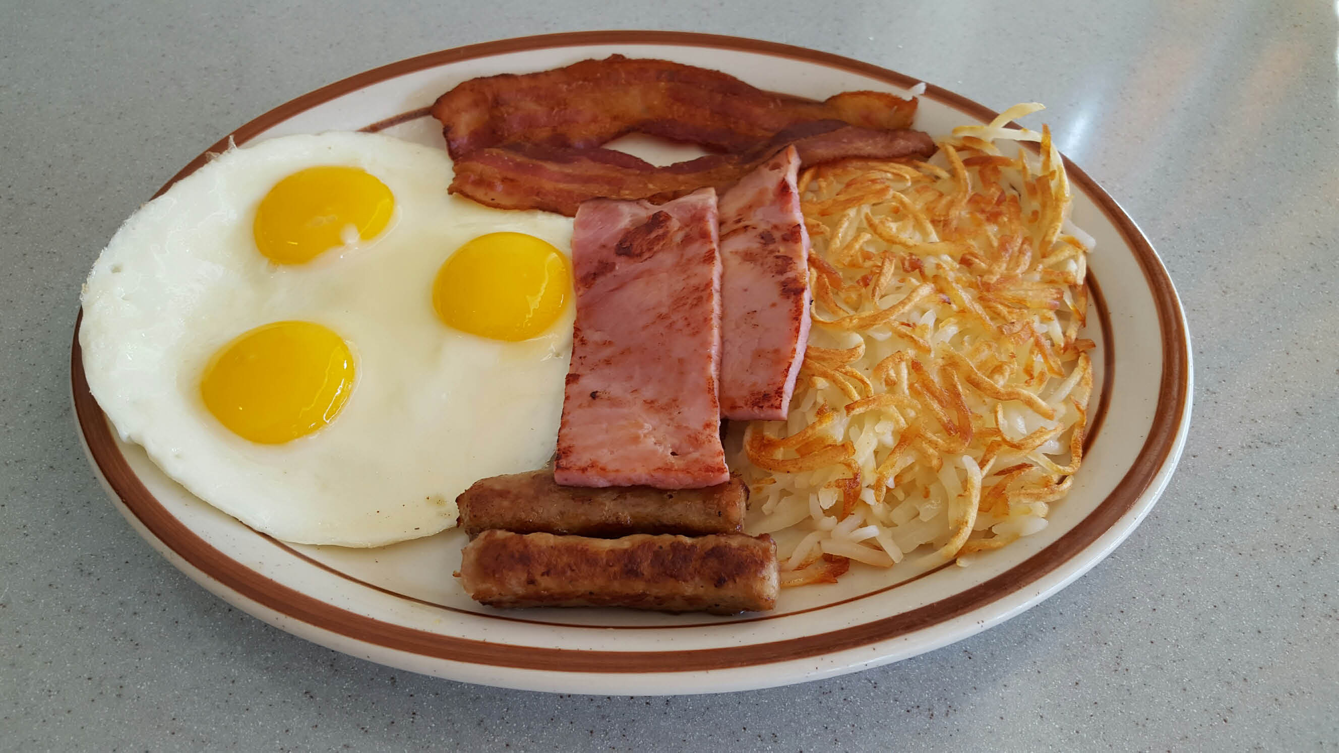 Get hash browns, bacon and eggs in Cerritos.