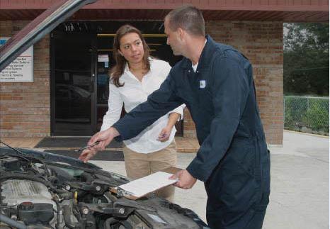 Trained professional mechanic helping a customer