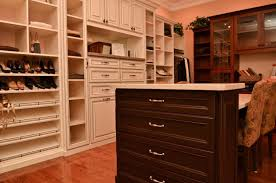 An organized closet space with dark and light wood; home storage solutions