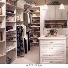 All white closet space with shelves and cabinets for clothing; Artisan Custom Closets; Atlanta, Georgia