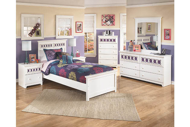 Ashley Furniture Twin Bed set includes dresser and mirror.