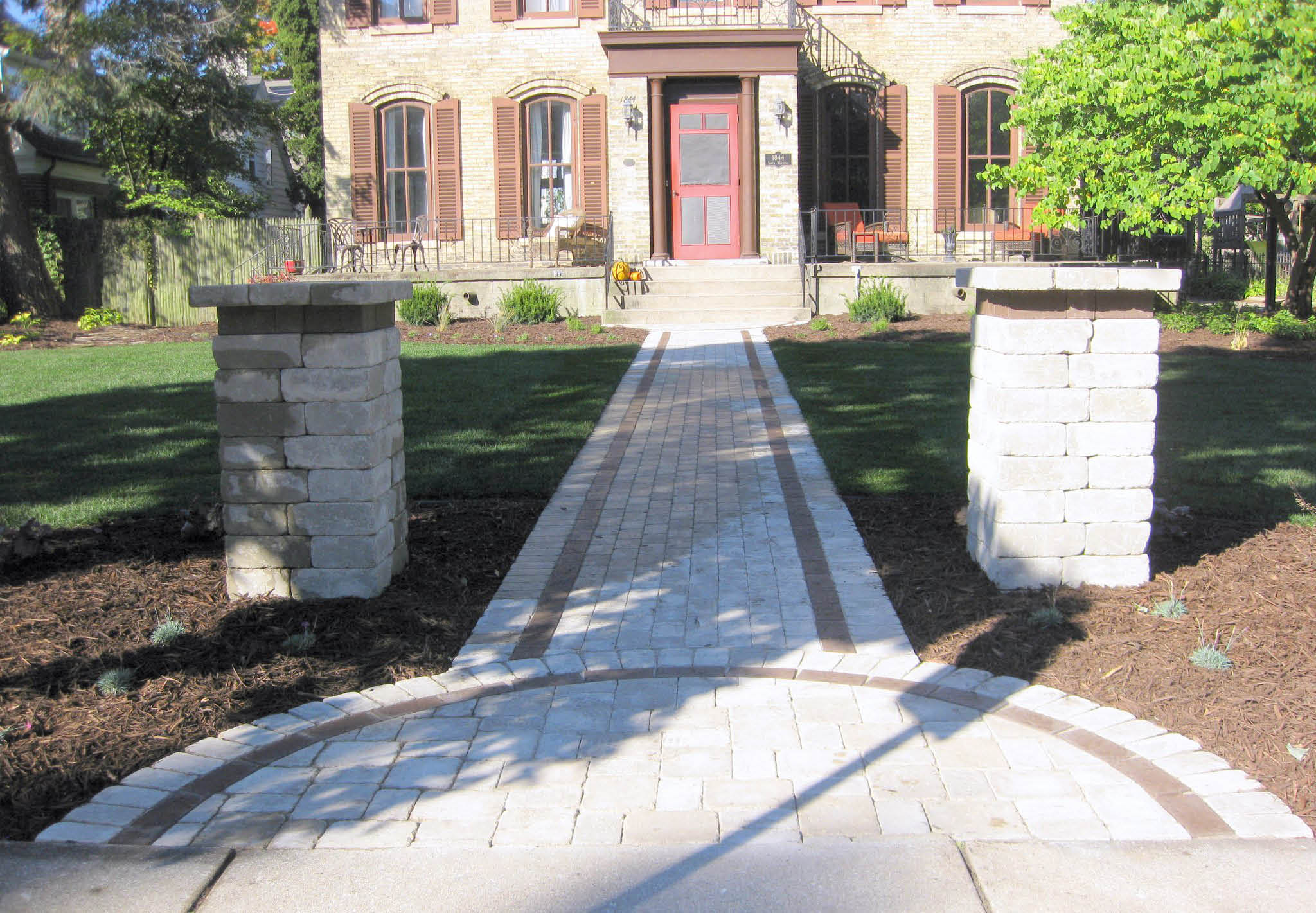 Picture of a landscape design of a patio block walkway designed by Aspen Properties in Racine, WI.