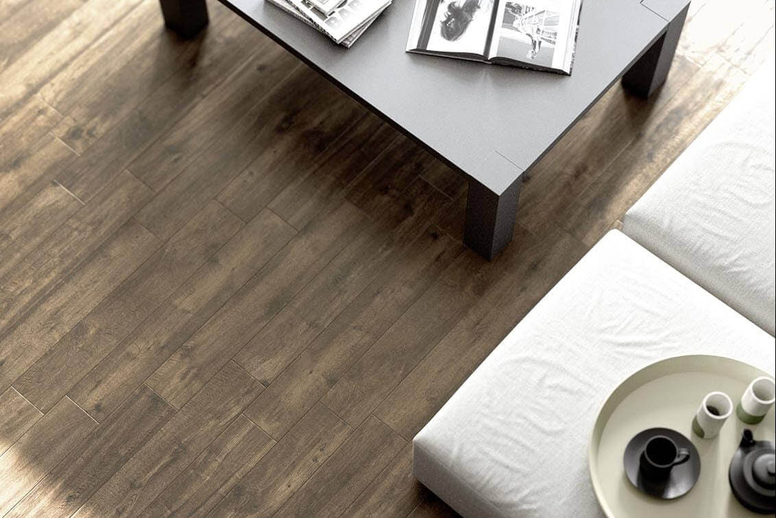 These porcelain tiles elegantly recreate the intricate detailing of wood flooring.