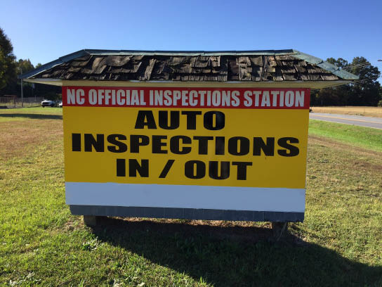Auto Inspections In/Out sign in Huntersville NC