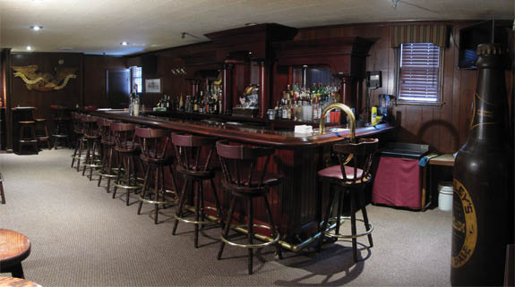 Our lounge boasts of a custom bar, great staff & a bar menu