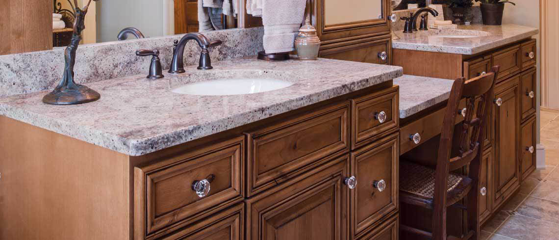 Stone counter tops steal the show in this bathroom.