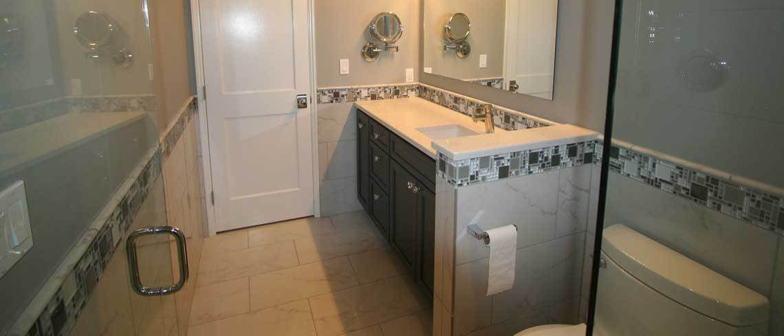 Mosaic and standard tile available in a stylish bath remodel.