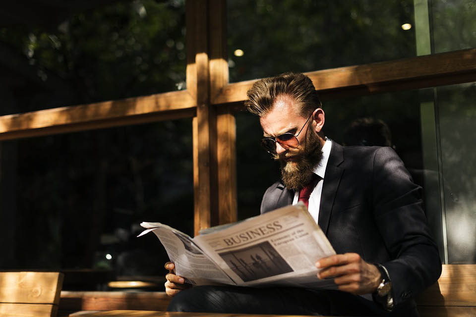 man reading the business section of the newspaper