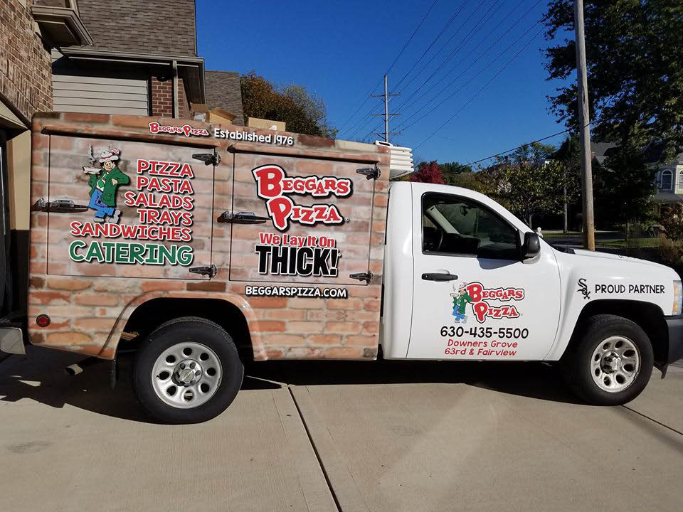 Photo of Beggar's Pizza delivery truck in Downers Grove, IL.