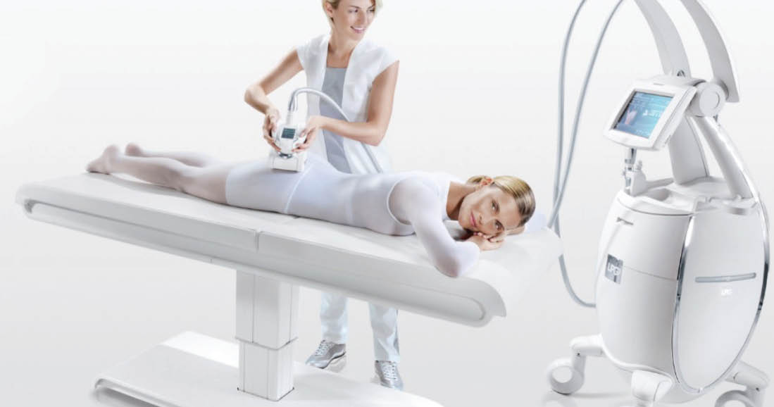 woman and treatment specialist in white procedure room performing Endermologie, Lipomassage™ treatment on legs and buttocks; Wellness centers in Agoura, CA