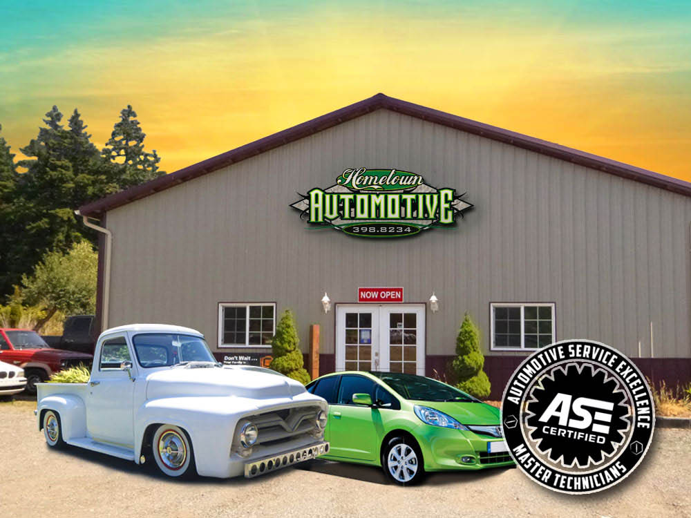 Hometown Automotive shop with classic truck and hybrid vehicle in front of it with ASE certified logo