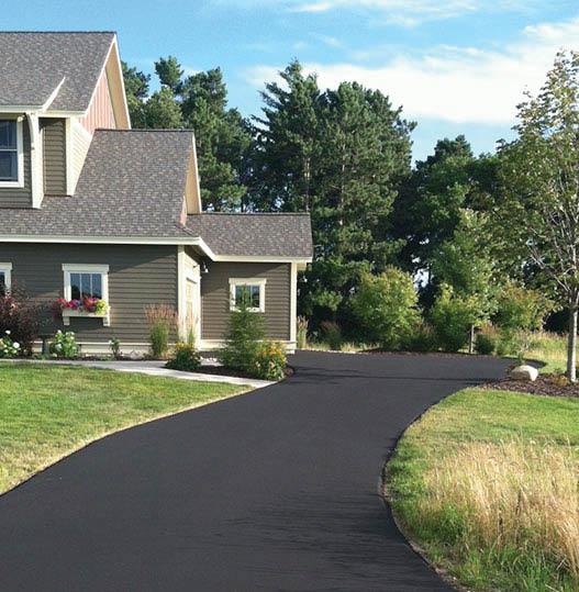 Sloping black top driveway