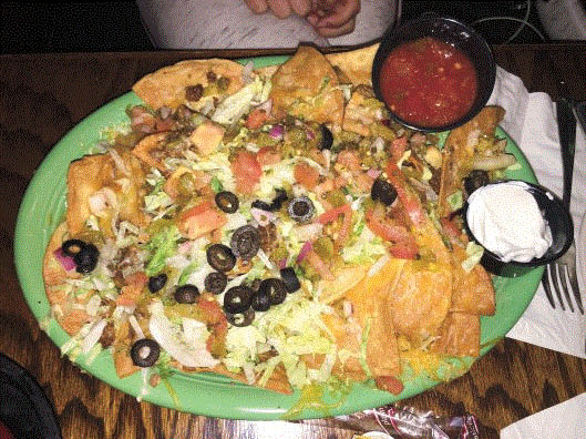 Picture of mile high plate of nachos at Brady's Tavern in Beverly Hills, MI