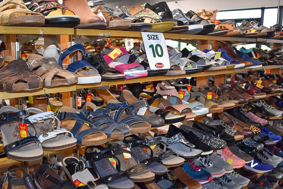 hundreds of shoes in all styles and sizes; Brown's Shoe Fit Co.