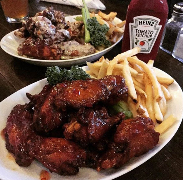 Buffalo wings with fries and salad in McHenry; pubs in Chicago, IL; sports bars