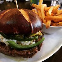 bleu cheese burger with pretzel bun and fries; McHenry bar and grill restaurants