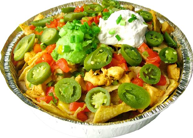 Loaded Chicken nachos, guacamole, sour cream, fresh cheeses, tomatoes and more