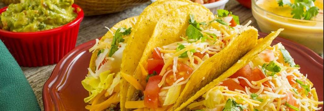 Delicious loaded Mexican tacos and guacamole make the perfect Mex meal banner