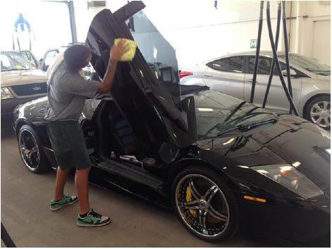 man detailing a car